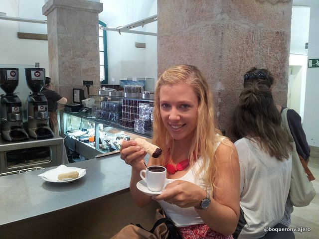 Abby eating melindres in the Chocolate Museum in Barcelona