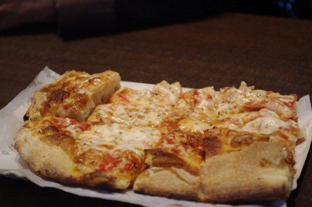 Trozo de pizza para degustar