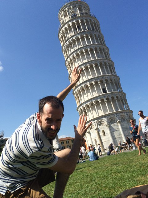 Pedro holding up the leaning Tower of Pisa