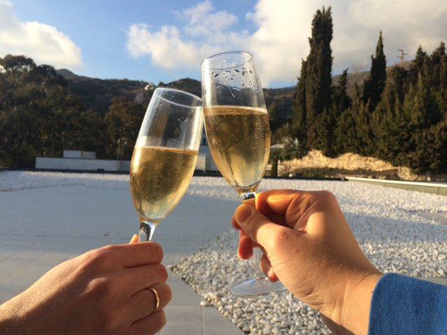 Toasting with cava in our room at the Hotel Balneario Lanjarón