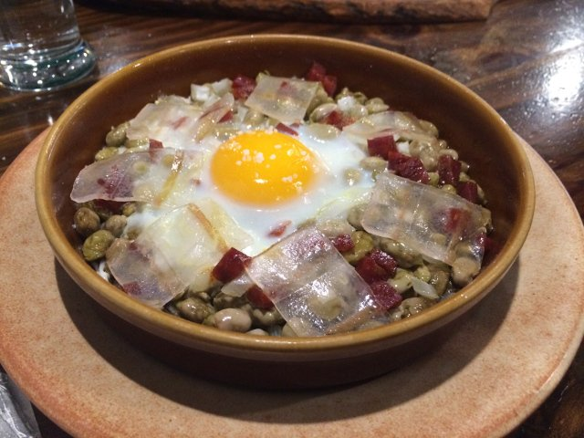 Baby broad beans with chorizo and egg in Lanjarón