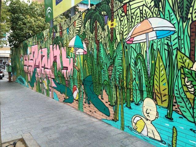 Arte callejero en Málaga en la pared de un colegio