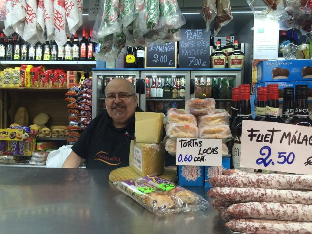 Trying cured meats in the Atarazanas Market with Devour Malaga
