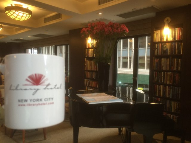 Enjoying a cup of coffee in the Reading Room of Library Hotel New York