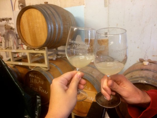 Trying some wine from the barrel at Barnstormer Winery