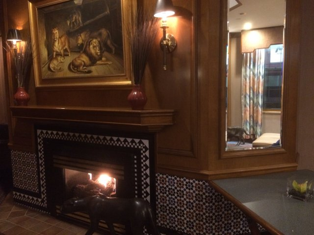 Lounge area in with a fire in the fireplace at the Casablanca Hotel New York
