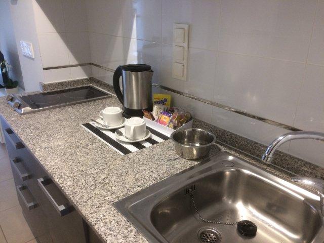 Cocina del apartamento Muchosol en Valencia