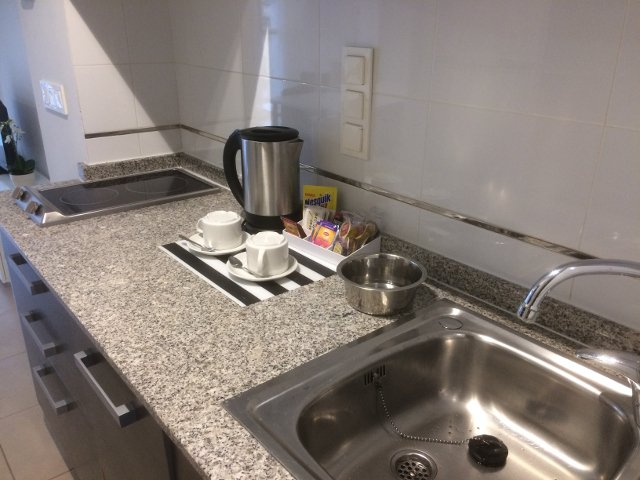 Kitchenette of our apartment with Muchosol in Valencia