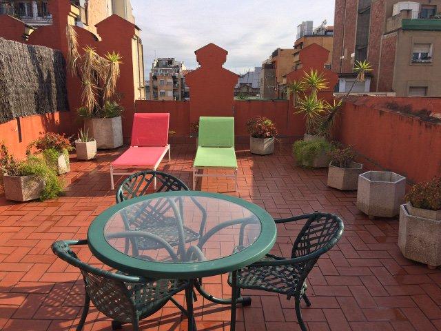 La terraza del ático en OK Apartamentos Barcelona