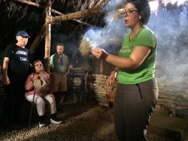 Our guide Angela shows us how to start a fire at the CAREX